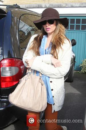 Nadine Coyle - Nadine Coyle leaves her house bound for a flight back to Los Angeles. She packs a luxury...