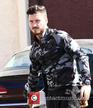 Val Chmerkovskiy - Val Chmerkovskiy autographs a pumpkin for a fan at the Dancing With The Stars rehearsal studio -...