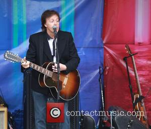 Paul McCartney - Paul McCartney showcases song from his latest album, New, from the back of a truck in London...