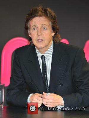 Paul McCartney - Paul McCartney signs copies of his new...