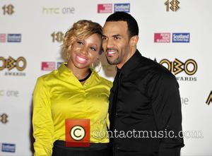 Craig David and Guest - Craig David arrives on the red carpet at the MOBO Awards 2013 - Glasgow, United...
