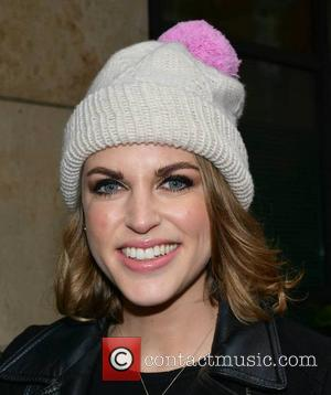 Amy Huberman - Despite the rain actress Amy Huberman was all smiles under her woolly hat and umbrella as she...