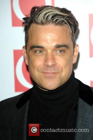 Robbie Williams - The Q Awards 2013 held at Grosvenor House - Arrivals - London, United Kingdom - Monday 21st...