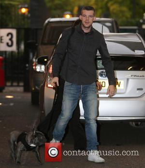 Russell Tovey - Russell Tovey and his dog called Rocky outside the ITV studios - London, United Kingdom - Tuesday...