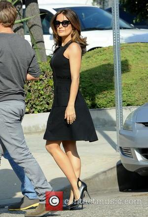 Salma Hayek - Wearing a black short dress, Salma Hayek is all smiles while filming a car scene in a...