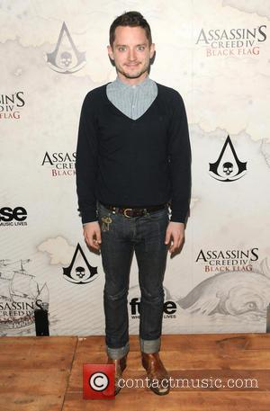 Elijah Wood - 'Assassin's Creed IV: Black Flag' launch party held at Greystone Manor - Arrivals - Los Angeles, California,...