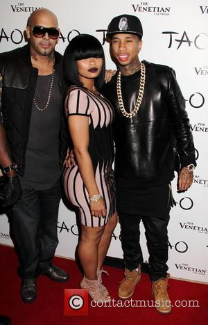 Tyga and Blac Barbie - Reality Television Star Kim Kardashian is joined by her family and fiance Kanye West, at...