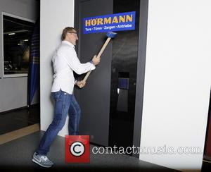 Michael Schumacher - Michael Schumacher has some fun trying to break into a room - Kerpen, Germany - Saturday 26th...