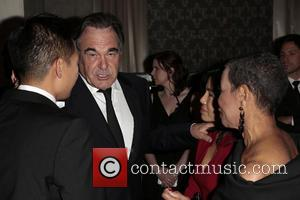 Oliver Stone, Sun-jung Jung and Mary Schmidt Campbell
