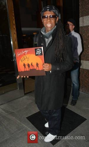 Nile Rodgers - Chic frontman Nile Rodgers spotted at The Fitzwilliam Hotel and signs a copy of his hit record...