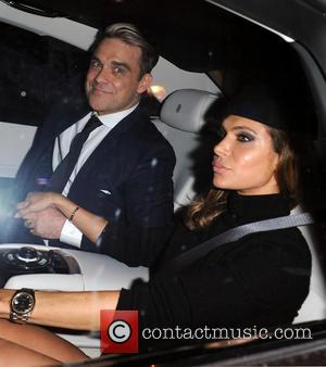 Robbie Williams and Ayda Field - Unicef Halloween Ball held at One Mayfair - Departures - London, United Kingdom -...