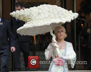 Lady Gaga - Lady Gaga seen leaving her hotel under a shell umbrella. - London, United Kingdom - Thursday 31st...