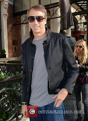 Tony Hawk - Pro Skateboarder Tony Hawk & girlfriend Cathy Goodman spotted walking with coffees at The Shelbourne Hotel... -...