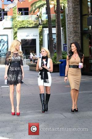 Brandi Glanville and Kim Richards - Beverly Hills housewives at Universal Studios walking in the patio and on EXTra set...