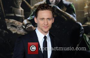 Tom Hiddleston - Los Angeles premiere of 'Thor: The Dark World' at El Capitan Theatre - Arrivals - Los Angeles,...