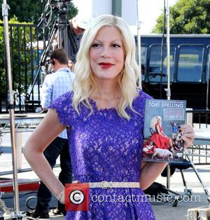 Tori Spelling - Tori Spelling arrives at The Grove for her appearance on Extra to promote her book 'Spelling It...
