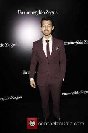 Joe Jonas - Celebrities attend the new global store opening of Ermenegildo Zegna Boutique on Rodeo Drive in Beverly Hills....