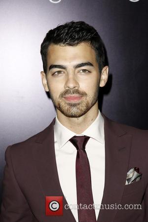 Joe Jonas - Ermenegildo Zegna Boutique Rodeo Drive Opening