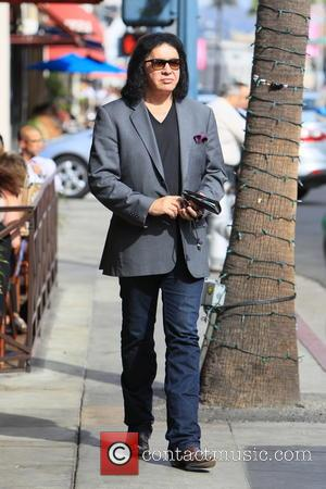 Gene Simmons - Gene Simmons seen leaving Panini Cafe in Beverly Hills. He goes to his car to show the...