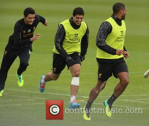 Glen Johnson and Luis Suarez - Liverpool striker Luis Suarez trains with a bandage below his left knee the day...