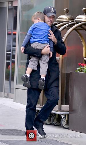 Carson Daly and Jackson Daly - Carson Daly carries his sleeping son Jackson outside his Manhattan hotel - Manhattan, New...