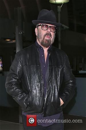 Dave Stewart - Dave Stewart arrives to LAX in cool Fashion and style as he gives the thumbs up in...