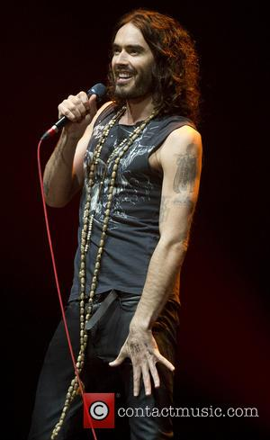 Russell Brand - Russell Brand performs to a sold-out crowd at the Heineken Music Hall on his 'The Messiah Complex'...
