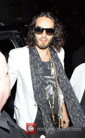 Russell Brand - Comedian and Actor Russell Brand seen arriving at the Stage door of the Olympia Theatre for his...