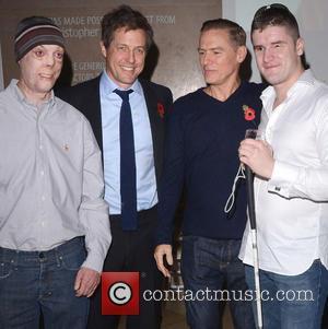 Guest, Hugh Grant and Bryan Adams