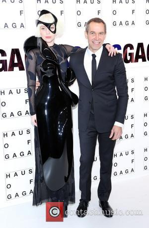 Jeff Koons and Lady Gaga - Lady Gaga Presents 'artRave' at Brooklyn Navy Yard on November 10, 2013 in the...