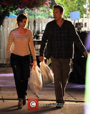 Jennifer Lopez and John Corbett - Jennifer Lopez having good laughs with co-star John Corbett while throwing out the trash...