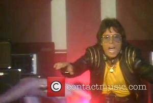 Sir Cliff Richard - Comedian Alan Carr dressed as rollerskating Cliff Richard from the video Wired For Sound on...