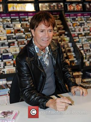 Sir Cliff Richard - Sir Cliff Richard signed copies of his new album and DVD for fans in Birmingham at...