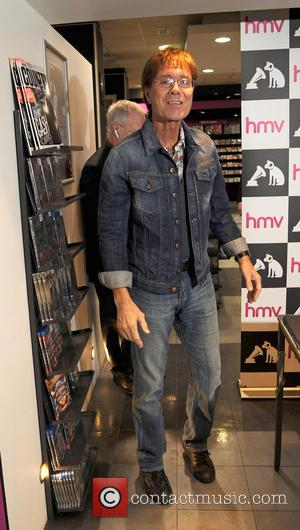 Sir Cliff Richard - Sir Cliff Richard Signing his Album Rock N Roll Songbook at HMV Manchester. Sir Cliff Richard...