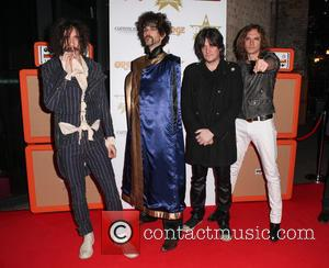 Justin Hawkins, Frank Poullain, Dan Hawkins, Ed Graham and The Darkness