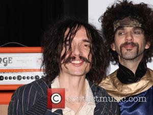 Justin Hawkins, Frank Poullain and The Darkness