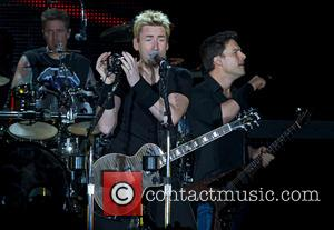Daniel Adair, Chad Kroeger, Ryan Peake and Nickelback