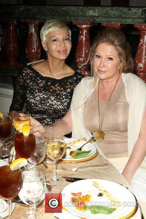 Kathy Hilton and Guest