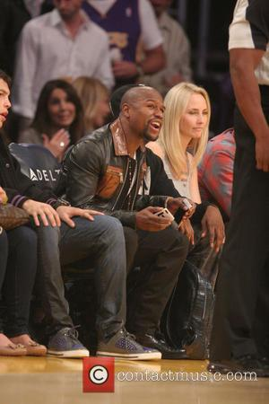 Floyd Mayweather Jr. - Friday November 15, 2013; Celebs out at the Lakers game. The Memphis Grizzlies defeated the Los...