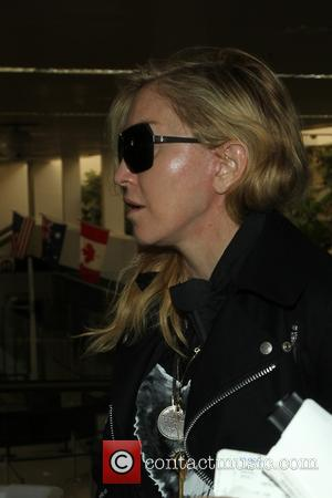 Madonna - Madonna at LAX for a departing flight - Los Angeles, California, United States - Monday 18th November 2013