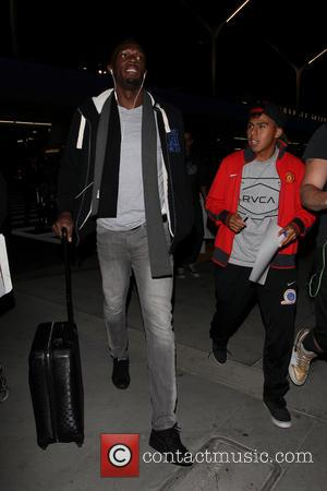 Usain Bolt - Usain Bolt arrives at LAX airport - Los Angeles, California, United States - Monday 18th November 2013