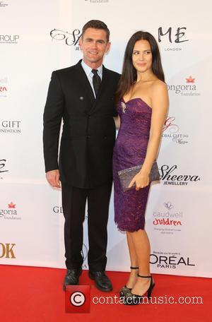Scott Maslen and guest - The 4th Annual Global Gift Gala held at ME hotel - Arrivals - London, United...