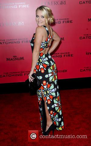 Emily Osment - The Hunger Games Catching Fire Premiere - Los Angeles, California, United States - Tuesday 19th November 2013