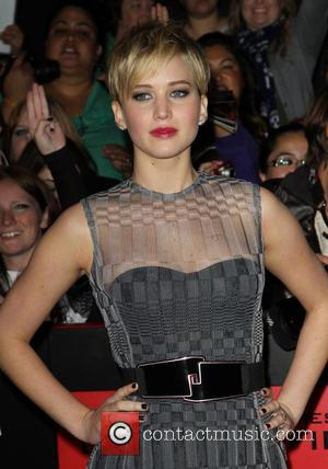 Jennifer Lawrence Calls Friend Taylor Swift A 'Badass Bitch' For Standing Up To Apple Music