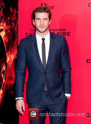 Liam Hemsworth Hosts Hunger Games Screening For Charity