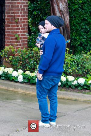Mike Comrie and Luca Comrie - Mike Comrie in matching beanie hat with son Luca as they head to Baby...