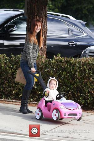 Alyson Hannigan and Satyana - Alyson Hannigan takes daughter Satyana out shopping in a toy mini car in Brentwood -...