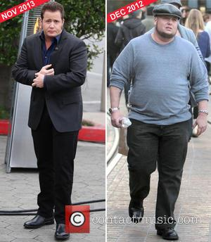 Chaz Bono -   And he's a lot richer for his weightloss efforts - Bono's proud mum cheered on...
