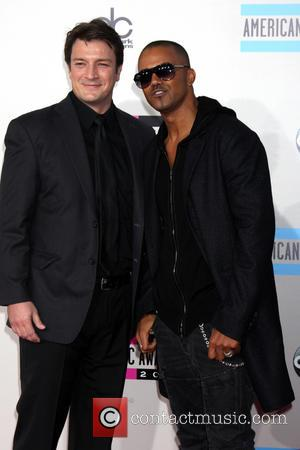Nathan Fillion and Shemar Moore - American Music Awards 2013 Arrivals at the Nokia Theater in Los Angeles - Los...
