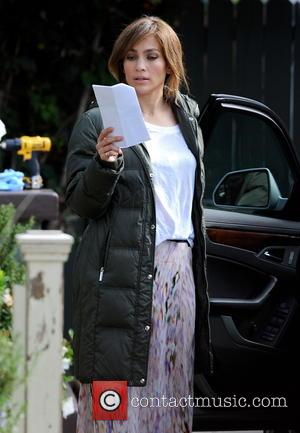 Jennifer Lopez - Actress Jennifer Lopez goes through her lines before filming a scene with co star Ian Nelson on...
